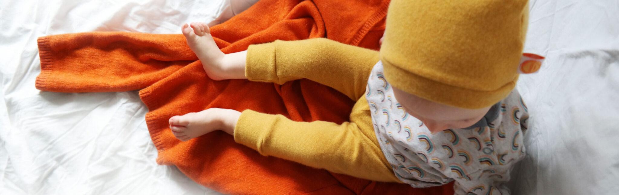 Titalbild Jawoll Baby Wollhose und Wollmütze Gelb